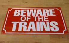 Enamel Railway Station Beware of Trains sign.
